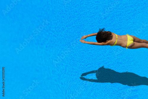 girl diving in the swimming pool