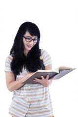 Asian female student reading book