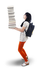 Asian female student bring pile of books - isolated