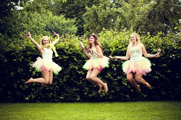 beautiful happy young women jumping.