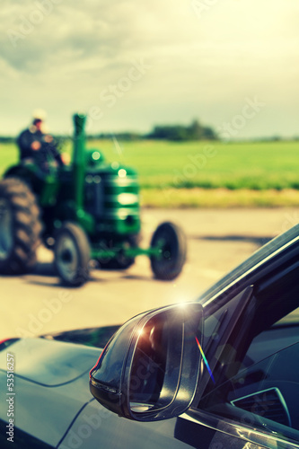 tractor passing car