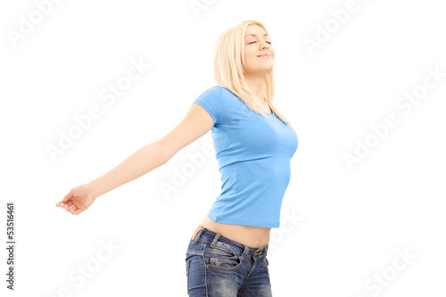 Relaxed casual female spreading her arms