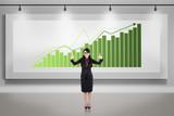 Asian businesswoman thumbs up on growing bar chart billboard