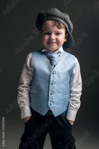 Little boy in cap and blue vest