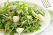 Salad with ruccola leaves, cheese and spinach.