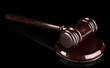 Wooden gavel on black background