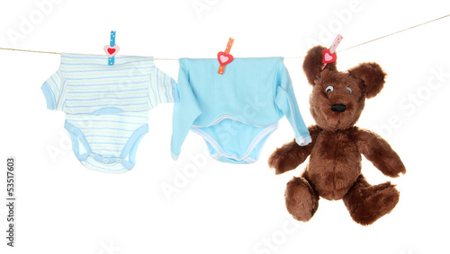 Baby clothes hanging on clothesline, isolated on white