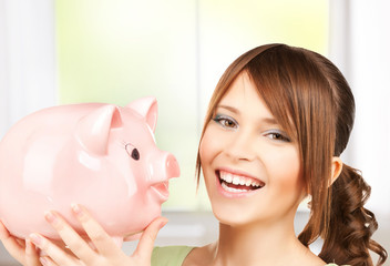lovely girl with big piggy bank