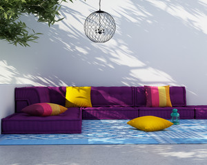 Luxury outdoor summer lounge space with sofa and cushions