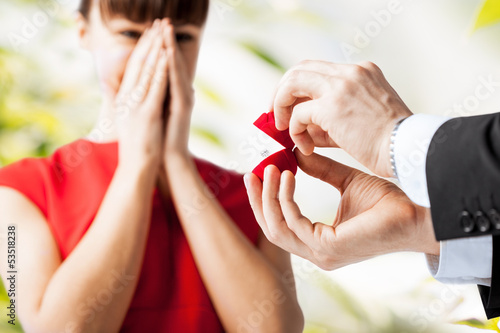 couple with wedding ring and gift box