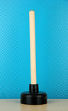 Toilet plunger on blue background