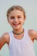 Summer joy - portrait of lovely girl on the beach