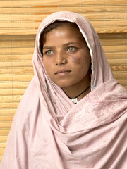 Portrait of Poor muslim woman with headscarf