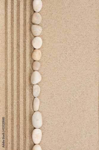 Stripe of white stones lying on the sand
