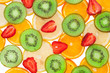 Sliced ​​orange, lemon, strawberry and kiwi