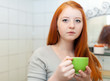 teenager with cup of medicine gargling