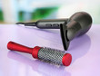 hair dryer and comb brush, on table in beauty salon