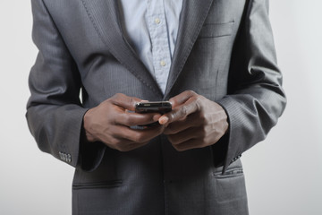 African-American man using smartphone