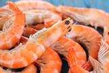 Fototapety Shrimps on blue wooden table