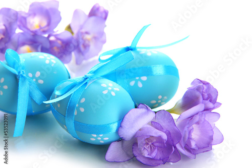 Bright easter eggs with bows and flowers, isolated on white