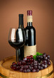 Composition of wine bottles, glass of red wine, grape