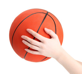 Basketball in woman hand isolated on white