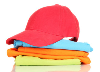 Red peaked cap with T-shirts isolated on white