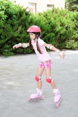 Little girl in roller skates at  park