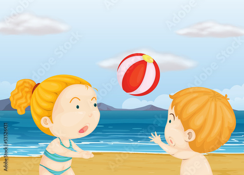Children playing volleyball at the beach