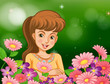 A smiling girl at the garden with flowers