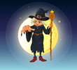 A witch holding a stick standing at the center of a full moon