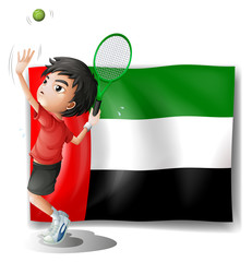A tired athlete player in front of the UAE flag