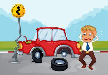 A worried man beside his damaged car