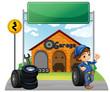 A boy standing beside a wheel outside the garage