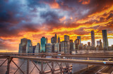 New York City. Terrific sunset view from Brooklyn Bridge with Sk © jovannig