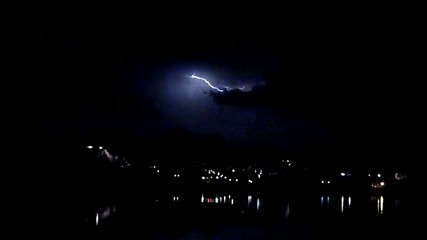 Lightening Storm Over Small Town Lake
