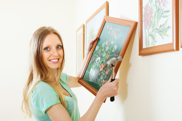 Positive blonde woman with picture