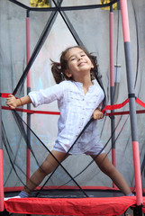 Girl in the trampoline