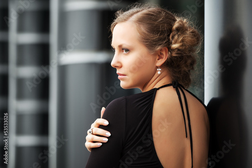 Sad beautiful woman daydreaming