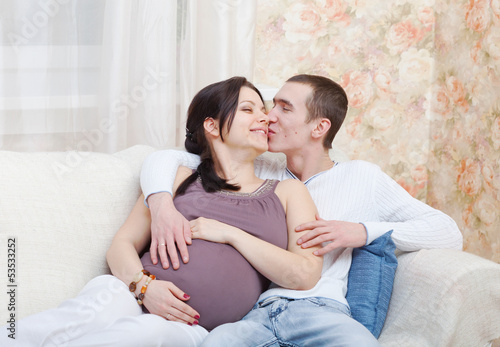 Happy pregnant woman with the husband