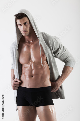 Portrait of a muscle man posing in studio