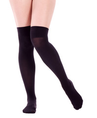 Sexy womanish legs isolated on the white
