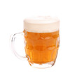 mug of beer with foam isolated on white