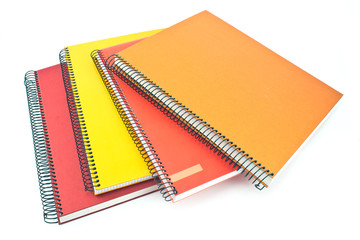Stack of colorful spiral notebooks