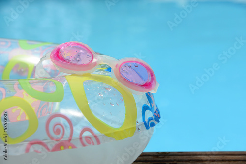 glasses, buoy and pool bottom
