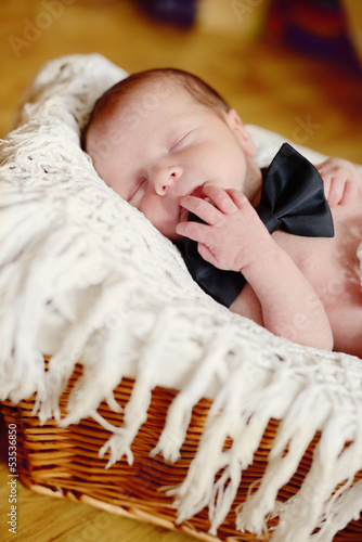 newborn boy wearing bow tie