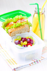 Bento lunch for child in school, box with sandwich and fruit