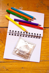 notebook with condom