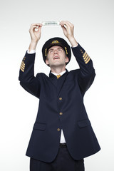 Young man in the form of a passenger plane pilot