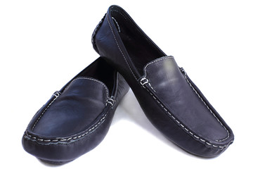 Black leather loafers on a white background.